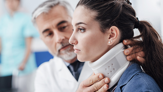 Personal Injury Patient with Neck Brace with Doctor